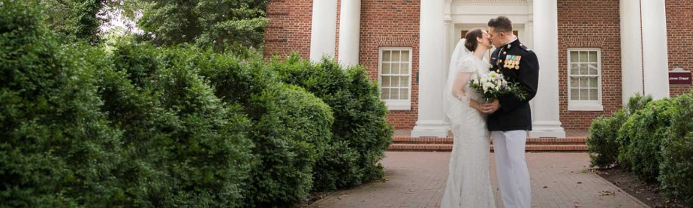 Bride and Groom standing in front of Jones Chapel