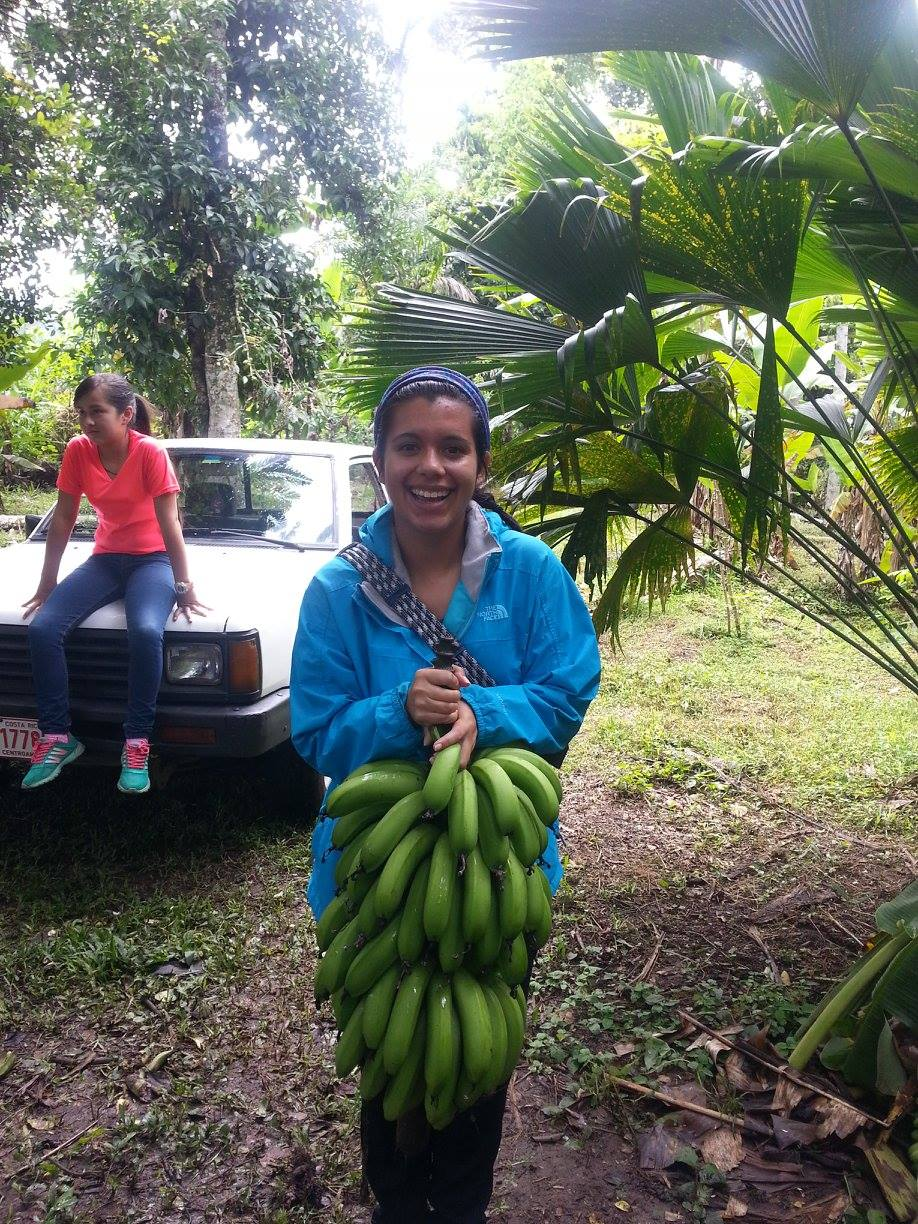 Student abby Ojeda with bananas in Costa Rica