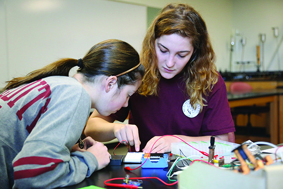 two female students in a science lab