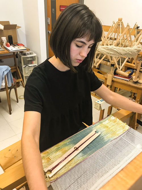 Jessie Taylor working in the art studio