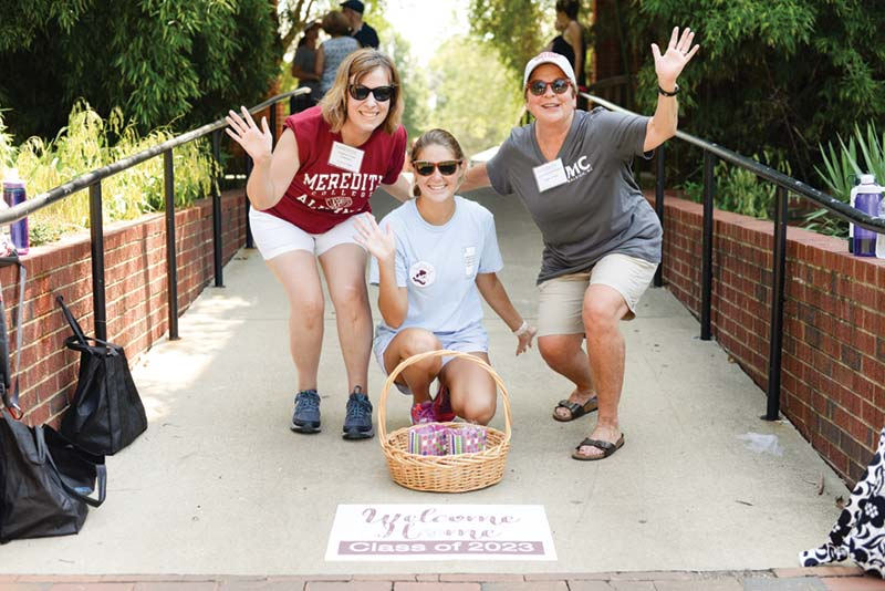 Alumnae holding a Welcome Basket on Move in Day 2019