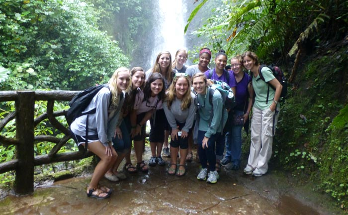 Students in front of waterfall during study abroad