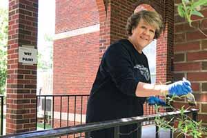 President Jo Allen painting hand rails