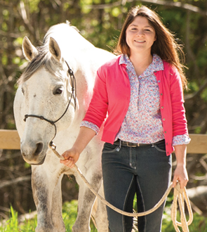 Picture of Allison Pappas with a white horse