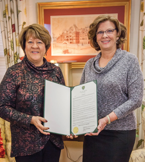 Mayor Nancy McFarlane presenting official proclamation to Dr. Allen