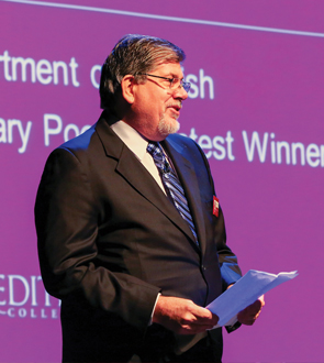 Picture of Poet and Faculty member Robert Rubin reading poem The Girls