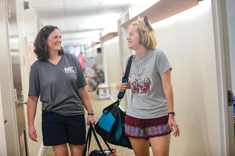 Haye's speaking with Rachel in Dorm Hallway