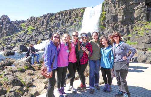 Students in front of waterfall for study abroad trip
