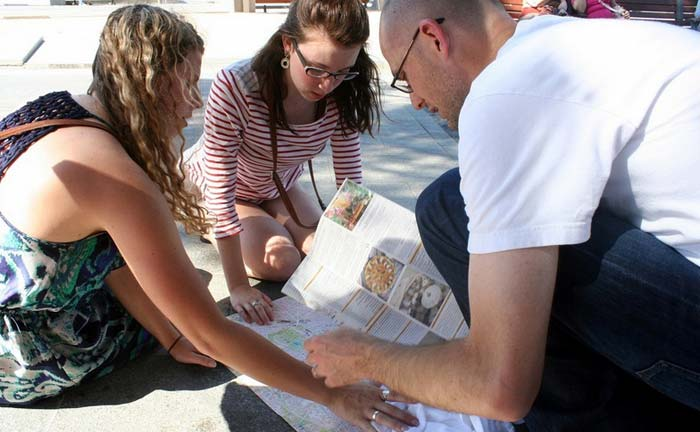 Students and Professor studying map while abroad