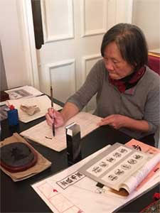 Adjunct professor Grace Huey-Yuh Lin leading a Chinese calligraphy demonstration