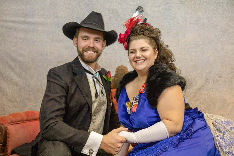 Meredith Theatre production photo of actors as Frank Butler and Annie Oakley. They are wearing old west costumes