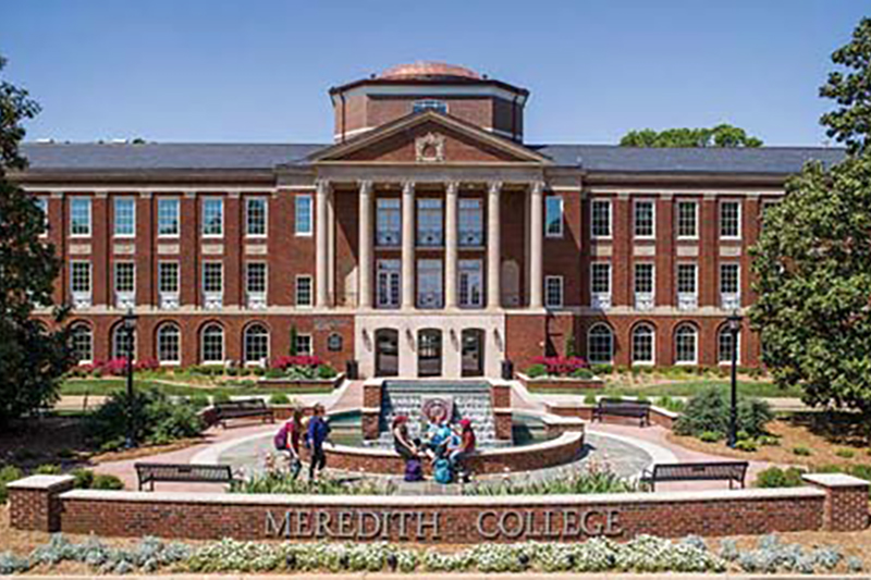 Image of Johnson Hall with words Meredith College on fountain.