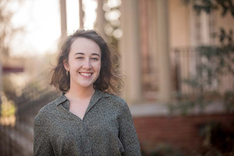 Profile photo of Belle Williams with Joyner Hall in the background