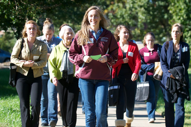 Student leads a campus tour during Discover Meredith