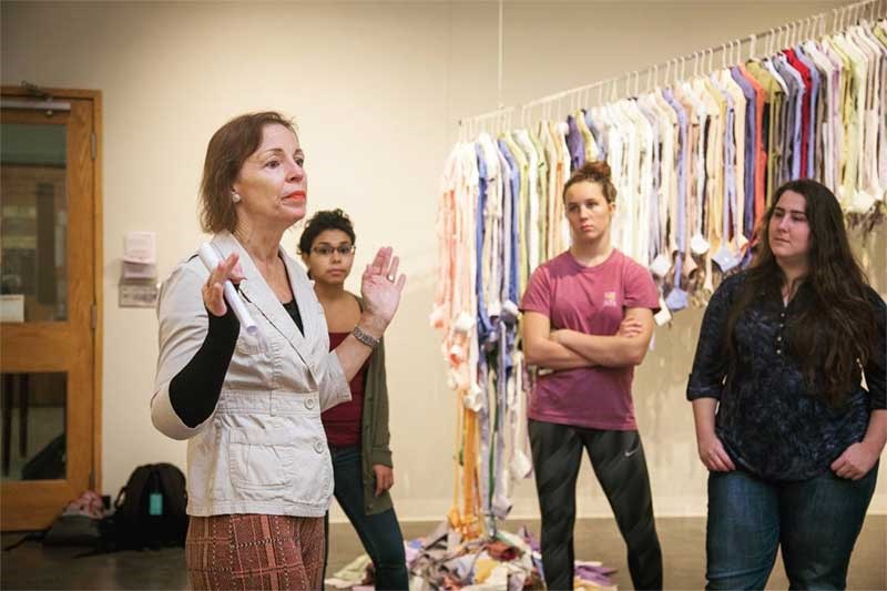 Artist Joyce Watkins King talks about her exhibition, Fast Fashion Fiasco, with Meredith students