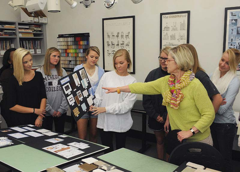 Interior Design classroom with students and faculty presenting work