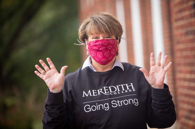 Jo Allen waving with COVID Mask on
