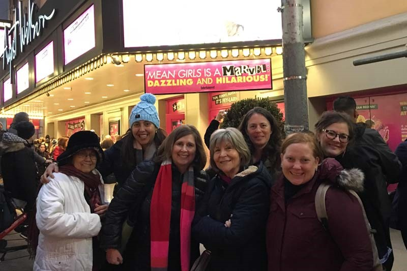 Group photo of alumnae at a broadway show