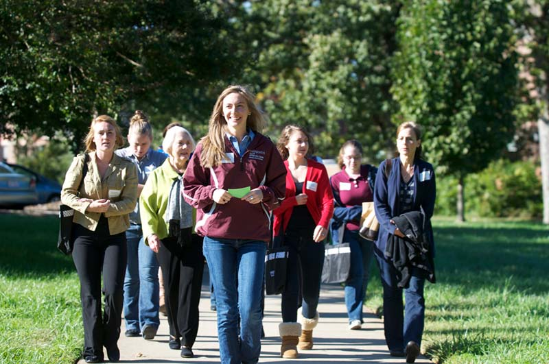 a group of women walking through campus