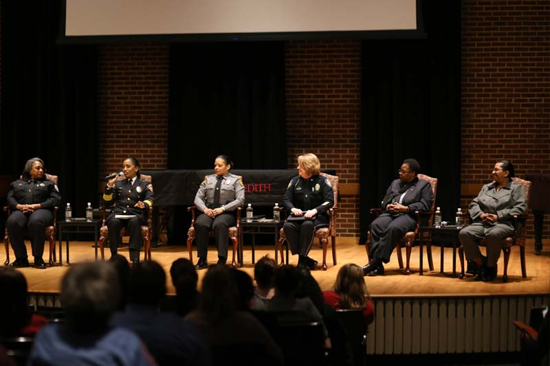 Six women police chiefs on stage at Meredith College