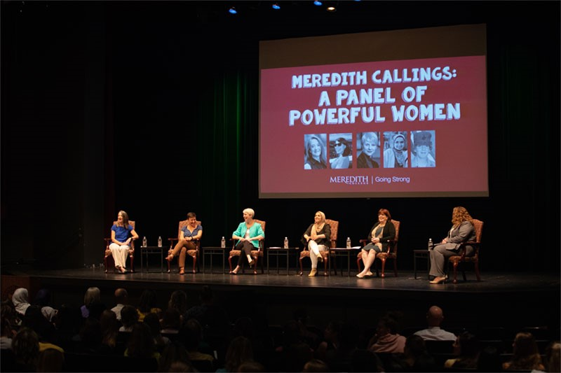 Summer Reading Panel Discussion photo of six women on stage