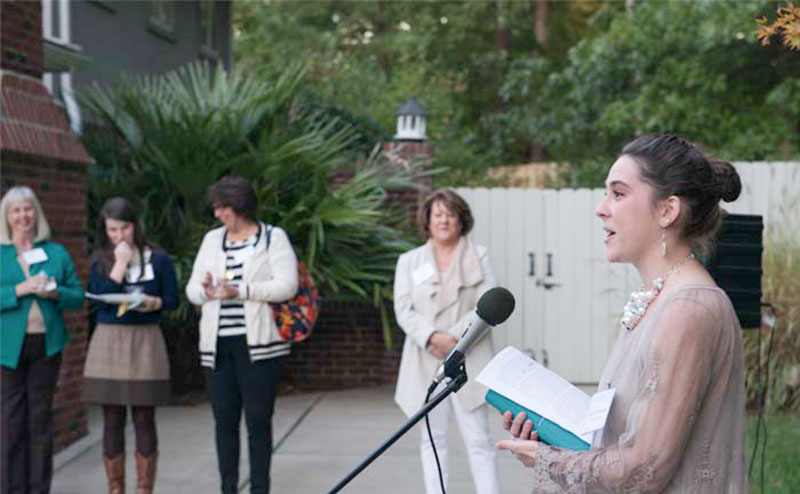 Student speaks to guests at Campaign event