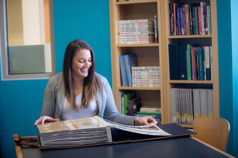 Female Interior Design student looking at fabric samples