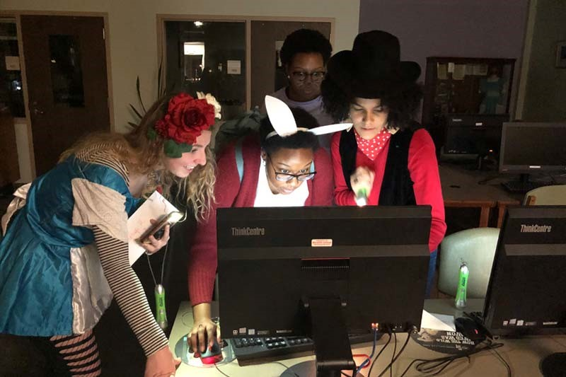 Students work on clues during Library Murder Mystery Night