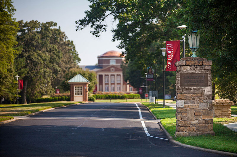 Front gate to Meredith with Johnson Hall in the background.