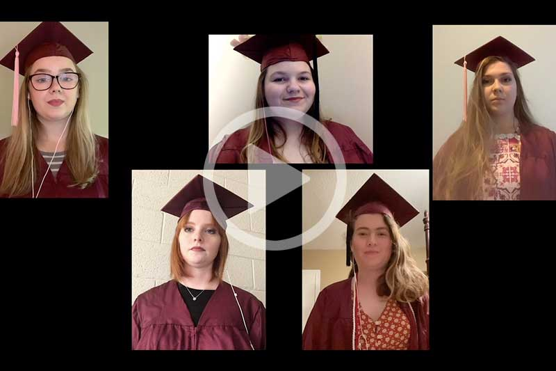 Students singing Alma Mater