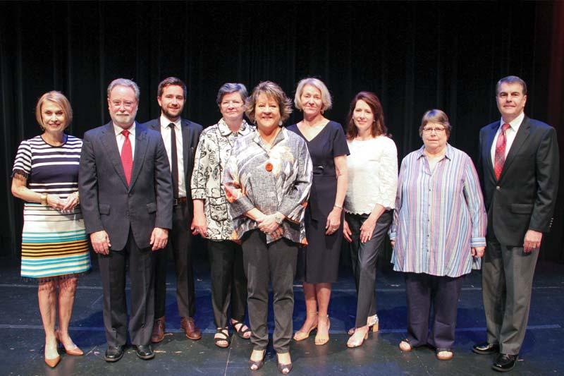 Dr Allen and Alumnae Award Recipients standing on Jones Auditorium Stage
