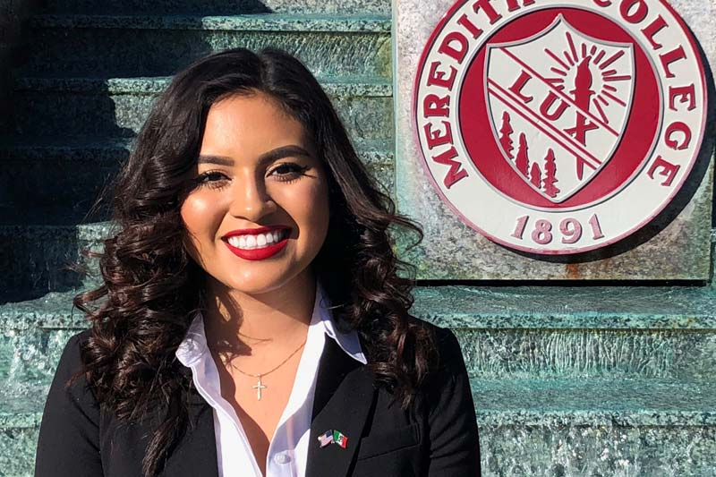 Profile photo of Andressia Ramirez in front of the Johnson Hall fountain
