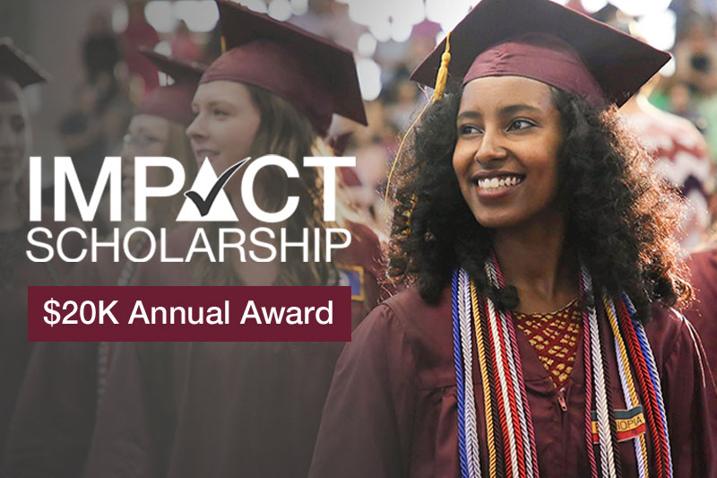 Student at commencement. Impact Scholarship. $20K annual award.