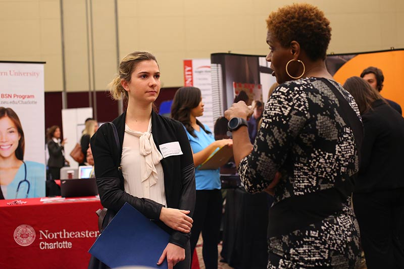 A Meredith student talking to a recruiter at the career fair.