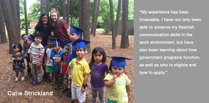 Catie Strickland -spanish intern posing in wooded area with children with text My experience has been invaluable. I have not only been able to advance my Spanish communication skills in the work environment, but have also been learning about how government