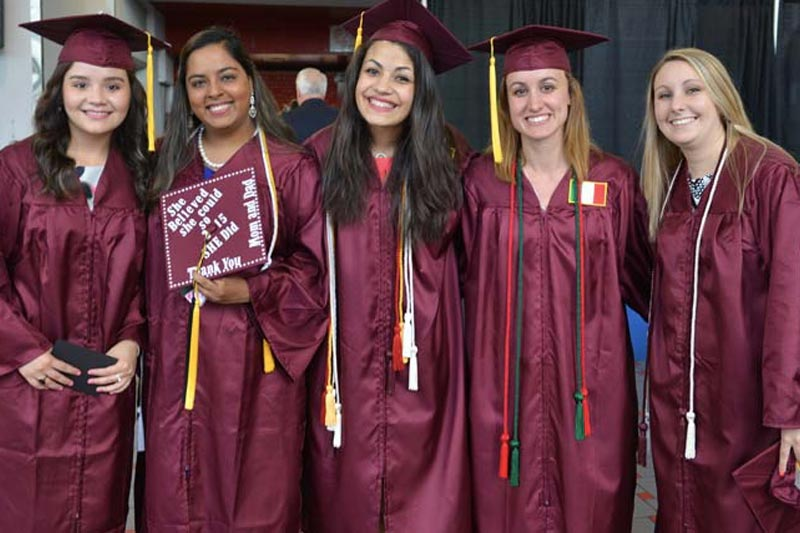 Five Commencement Graduates in Regalia