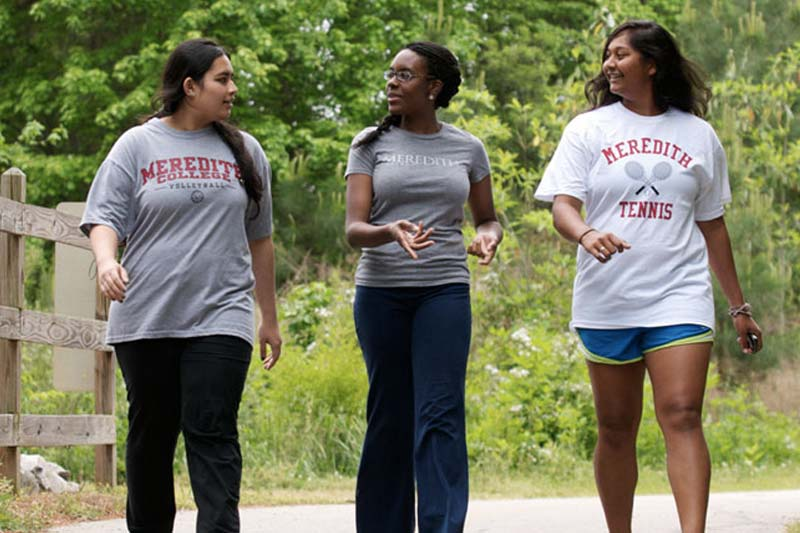 Three Meredith Students walking on the Greenway