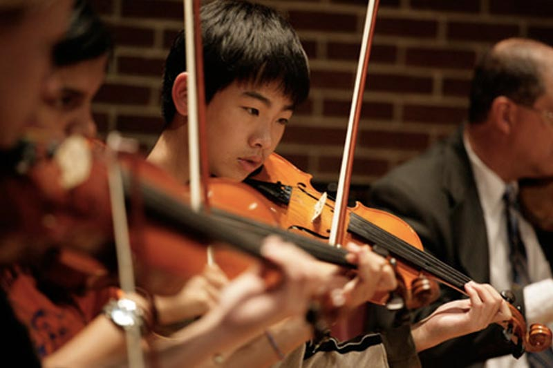 Young man playing violin