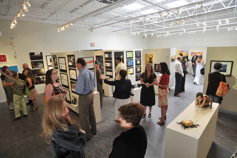 Visitors viewing student artwork in Weems Gallery