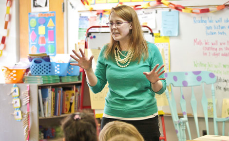 Elementary school teacher teaching in classroom