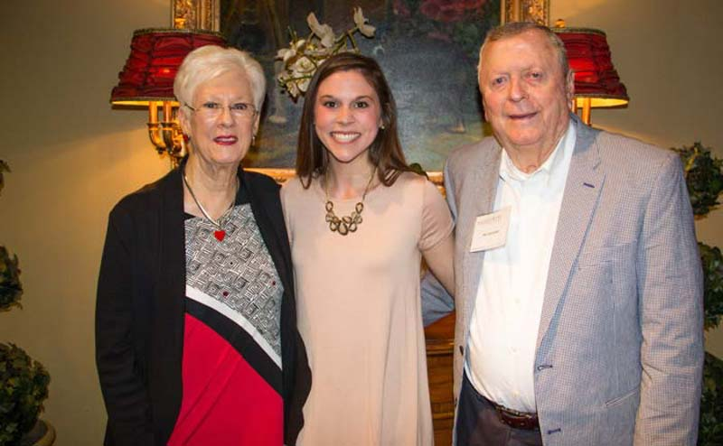 Student with her grandparents at Grandparent Luncheon