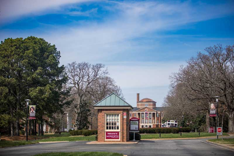 Guard House on main campus drive with Johnson Hall visible in the distance