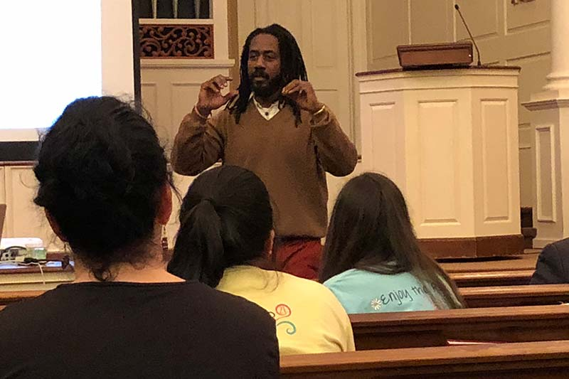 Carlton Mackey speaking to Meredith students, faculty, and staff.