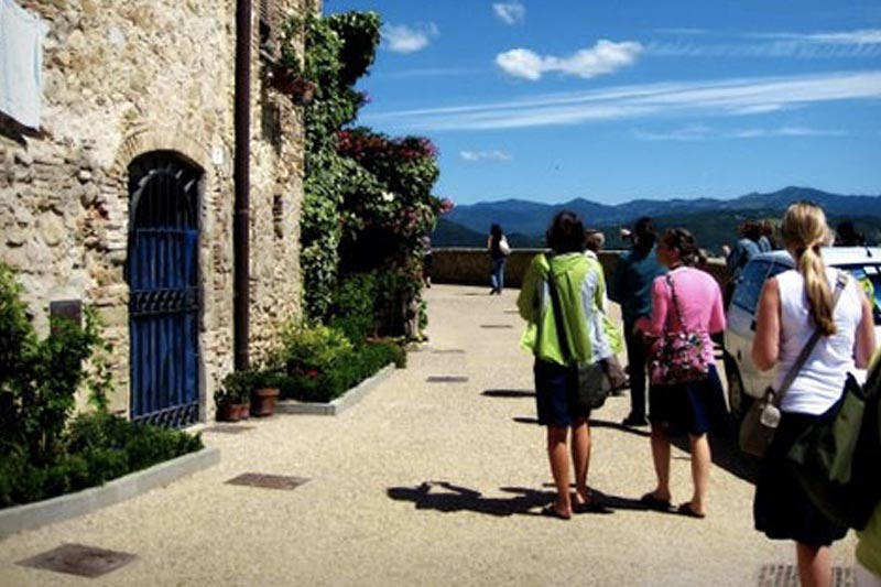 Students walking on cobble stone streets in Italy