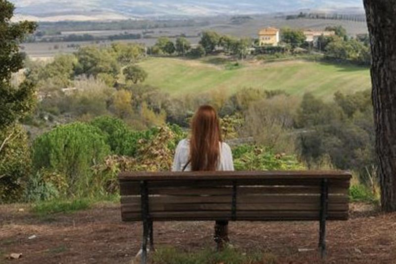 Italian Countryside with Student on Bench looking off into the distance