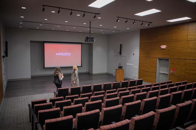 Two females speaking in Kresge Auditorium