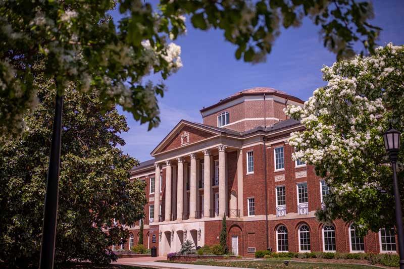 Johnson Hall behind foliage