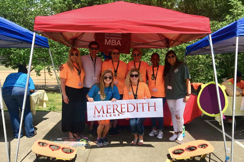 MBA Charity Event - Students under tents
