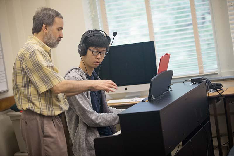 Music Camps : Piano Professor Teaching Young Man