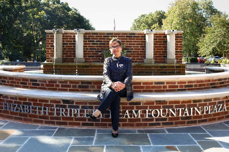 Donor Elizabeth Beam sits in front of the Elizabeth Triplett Beam Fountain Plaza